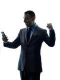Silueta del teléfono del hombre de negocios aislada Foto de archivo