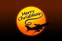 Silueta del texto del aeroplano y de la Navidad del saludo Fotos de archivo