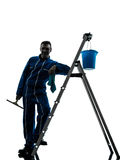 Silueta del trabajador del limpiador de ventana del hombre Fotografía de archivo libre de regalías