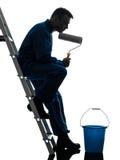 Silueta del trabajador del pintor de casa del hombre Imagen de archivo