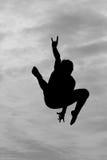 Silueta del trampolín en cielo Imagen de archivo