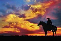 Silueta del vaquero Imagenes de archivo