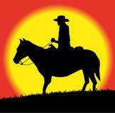 Silueta del vaquero en caballo Fotos de archivo libres de regalías