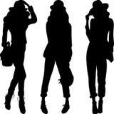 Silueta del vector de los modelos superiores de las muchachas de la moda Imagen de archivo