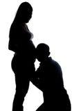 Silueta del vientre del marido que escucha y de la esposa Fotografía de archivo libre de regalías
