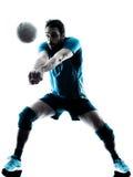 Silueta del voleibol del hombre Fotografía de archivo