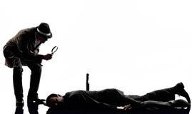 Silueta detective de las investigaciones de criminales del hombre Foto de archivo
