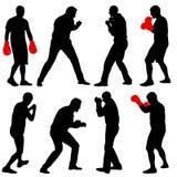 Silueta determinada del negro de un boxeador del atleta en un fondo blanco libre illustration