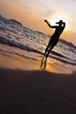 Silueta en la playa Imagen de archivo libre de regalías