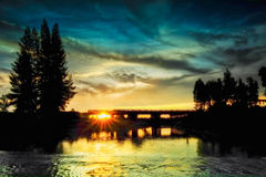 Silueta en la puesta del sol Fotos de archivo libres de regalías