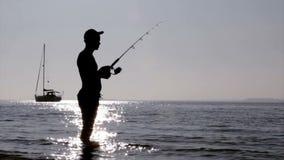 Silueta en los humedales de Ria Formosa, Algarve, Portugal del pescador Fotografía de archivo libre de regalías