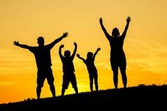 Silueta feliz de la familia Foto de archivo libre de regalías