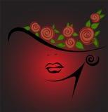 Silueta femenina en un sombrero con las rosas rojas Imagen de archivo libre de regalías