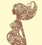 Silueta floral de la mujer embarazada Imagenes de archivo