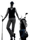 Silueta golfing del golfista de la mujer Fotos de archivo libres de regalías
