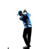 Silueta golfing del oscilación del golf del golfista del hombre Fotos de archivo libres de regalías