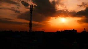 Silueta hermosa de la puesta del sol fotografía de archivo