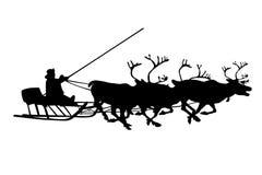 Silueta negra de los ciervos y de santa de la Navidad Fotografía de archivo
