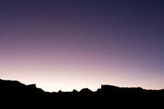 Silueta púrpura de la puesta del sol Fotografía de archivo