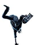 Silueta que anda en monopatín del skater del hombre Fotos de archivo