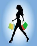 Silueta que va a hacer compras Foto de archivo libre de regalías