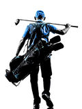 Silueta que camina golfing de la bolsa de golf del golfista del hombre Imagen de archivo libre de regalías