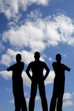 Silueta tres en el cielo de la nube Imagen de archivo libre de regalías