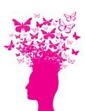 Silueta y mariposas principales rosadas Fotos de archivo libres de regalías