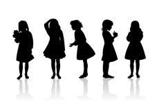 Siluetas 11 de los niños Foto de archivo