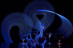 Siluetas abstractas con luminography del laser Fotos de archivo