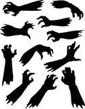 Siluetas asustadizas de las manos del zombi fijadas. Imagen de archivo libre de regalías