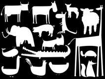 Siluetas blancas animales aisladas en negro Fotos de archivo libres de regalías