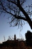 Siluetas de Bell y del árbol Foto de archivo libre de regalías