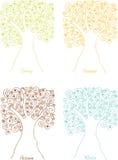 Siluetas de cuatro estaciones de los árboles de espirales Imágenes de archivo libres de regalías