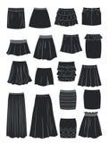 Siluetas de diversas faldas Foto de archivo libre de regalías