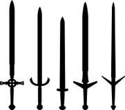 Siluetas de espadas medievales Imagen de archivo libre de regalías
