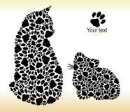 Siluetas de gatos de pistas del gato Imagen de archivo libre de regalías