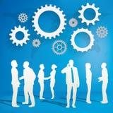 Siluetas de hombres de negocios con concepto del engranaje Imagen de archivo