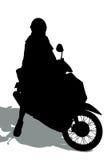 Siluetas de hombres en una motocicleta Imagen de archivo