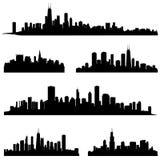 Siluetas de la ciudad fijadas. Colección del paisaje urbano. Foto de archivo libre de regalías