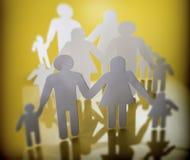 Siluetas de la familia con los niños aislados en fondo amarillo Fotos de archivo libres de regalías