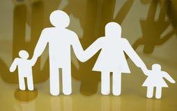 Siluetas de la familia con los niños aislados en fondo amarillo Imagenes de archivo