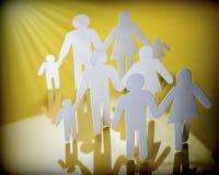Siluetas de la familia con los niños aislados en fondo amarillo Fotografía de archivo libre de regalías
