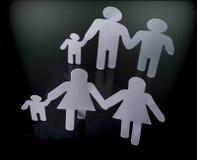 Siluetas de la familia con los niños aislados en fondo negro Foto de archivo libre de regalías