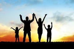 Siluetas de la familia feliz Imagen de archivo libre de regalías