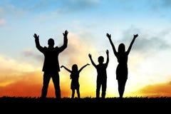 Siluetas de la familia feliz Imagen de archivo