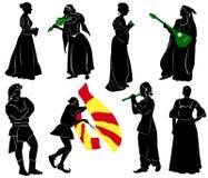 Siluetas de la gente en trajes medievales Imagen de archivo libre de regalías
