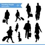 Siluetas de la gente que viajan Imágenes de archivo libres de regalías