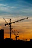 Siluetas de la grúa de construcción Foto de archivo libre de regalías