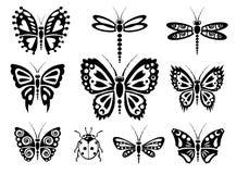 Siluetas de la mariposa Fotos de archivo